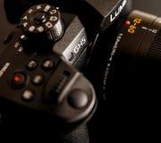 New Panasonic Lumix GH5 and Leica 12-60 camera lens. PARIS, FRANCE - APR 9, 2017: Close-up detail of buttons Panasonic Lumix DMC-GH5 - and Leica Vario-Elmarit 12 royalty free stock photos