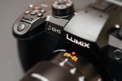 New Panasonic Lumix GH5 and Leica 12-60 camera lens. PARIS, FRANCE - APR 9, 2017: Color front view detail of the Panasonic Lumix DMC-GH5 - and Leica Vario royalty free stock image