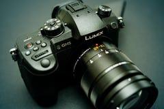 New Panasonic Lumix GH5 and Leica 12-60 camera lens. PARIS, FRANCE - APR 9, 2017: Green tone of the Panasonic Lumix DMC-GH5 - and Leica Vario-Elmarit 12-60 Micro royalty free stock images