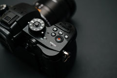New Panasonic Lumix GH5 and Leica 12-60 camera lens. PARIS, FRANCE - APR 9, 2017: Wireless button view detail of the Panasonic Lumix DMC-GH5 - and Leica Vario royalty free stock photo