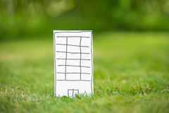 New paper highrise tower in grass Royalty Free Stock Photos