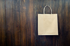 New paper pocket hanging on the wooden wall Royalty Free Stock Images