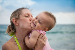 New Parents Play with Baby on the Beach Royalty Free Stock Photo