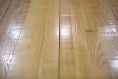 New parquet of brown color. New wood varnished parquet of brown color stock photography