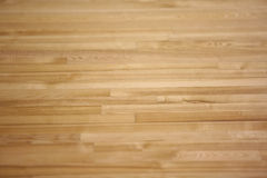 New parquet of brown color. New wood varnished parquet of brown color royalty free stock images