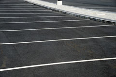 New paved empty parking lot with new painted strip lines Stock Photo