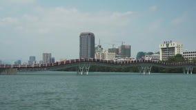 New pedestrian bridge Rainbow across the Sanya River stock footage video. Sanya, China - April 02, 2017: New pedestrian bridge Rainbow across the Sanya River stock video footage