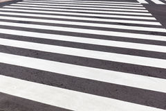 New pedestrian crosswalk in black and white on city street, safe Royalty Free Stock Photo