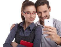 The new phone generation is playing. Royalty Free Stock Photography