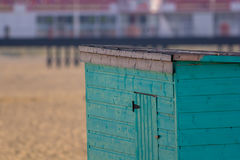 New pine wood beach hut primed and ready for painting at seaside Royalty Free Stock Photos