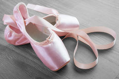 New pink ballet pointe shoes. On vintage wooden background Royalty Free Stock Photo