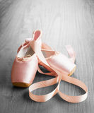 New pink ballet pointe shoes. On vintage wooden background Royalty Free Stock Photos