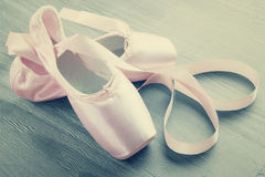 New pink ballet pointe shoes. On  wooden background in vintage style Stock Image