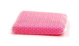 New pink kitchen sponge on white background. Stock Photos