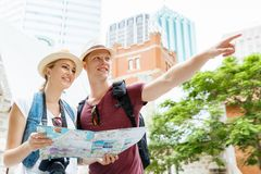 New places to explore. Happy young couple as tourists with a map Stock Photo