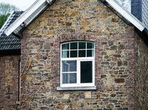 New plastic PVC window in old house Stock Photos