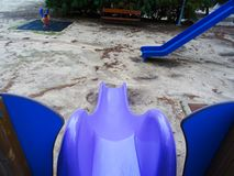 New plastic slide model in the park stock photo