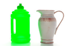 New Plastic Water Bottle and Old Ceramic Pitcher Royalty Free Stock Image