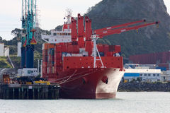 New Plymouth port, New Zealand. Container terminal in New Plymouth, New Zealand. Container vessel moored alongside the berth royalty free stock photography