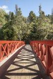 New Plymouth. Red railings and shadows of Poets bridge, Pukekura Park, New Plymouth. scenes. New Zealand Stock Photo