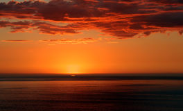 New Plymouth Sunset. Last sliver of the setting sun, viewed from New Plymouth, New Zealand stock photography