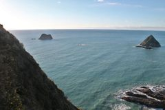 Paritutu Rock Ocean and Rock Views stock photos