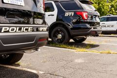 Noblesville - Circa July 2018: New police cars waiting for calls at the station III stock photography