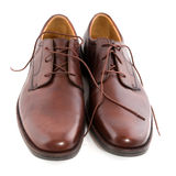 New polished brown shoes. New polished leather brown shoes isolated over white Stock Images