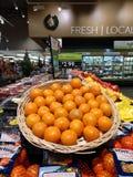 New pomegranates in supermarket royalty free stock image