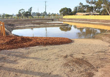 New pond in newly developed park Stock Photos