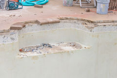 New pool brick coping work and repair. The fitting of new pool coping bricks Royalty Free Stock Photo