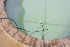 New pool filling with water. Resurfaced Diamond Brite pool plaster now being filled stock image