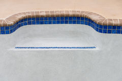 New pool remodel detail bench seat. Resurfaced Diamond Brite pool plaster detail and new pool tile work stock photography