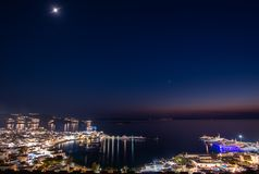 Mykonos harbors panoramic night shoot at blue hour in Greece. The NEW port is in an area called TOURLOS which is about 1.5 km but can be seen from town; it royalty free stock photography