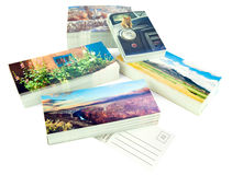 New postcards. Stacks of new postcards isolated on white. The cards are my production, I own the copyrights to all the images, no copyright infringement issues Royalty Free Stock Images