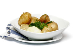 New Potato Boiled. In white Bowl with dill and butter isolated on white background Royalty Free Stock Images