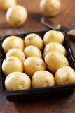 New potato in a container Stock Photo