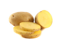 New potato with sliced half and slices isolated. On white background Stock Photos