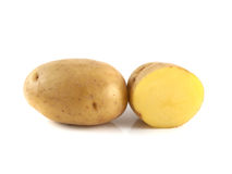 New potato with sliced half on white. Background Royalty Free Stock Images