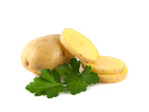 New potato with slices and green parsley isolated. On white background Royalty Free Stock Photography