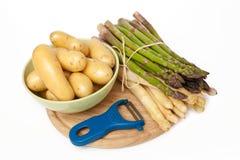 New potatoes, asparagus Royalty Free Stock Image