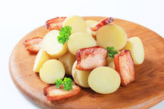 New potatoes and bacon Stock Photos