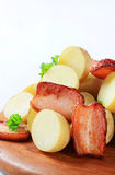 New potatoes and bacon Stock Photography