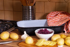New potatoes, a bowl of pickled cabbage and garlic. Royalty Free Stock Photos