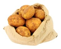 New Potatoes In A Brown Paper Bag. Fresh new potatoes in a brown paper bag isolated on a white background Royalty Free Stock Photos