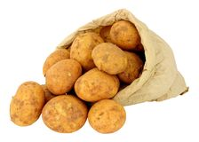 New Potatoes In A Brown Paper Bag. Fresh new potatoes in a brown paper bag isolated on a white background Stock Photography