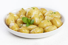 New Potatoes with Butter Parsley and Mint Stock Photo