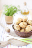 New potatoes in a clay bowl Stock Photos