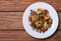 New potatoes with dill and fried pork top view Stock Photo