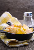 New potatoes fried in a cast iron skillet over Royalty Free Stock Photo